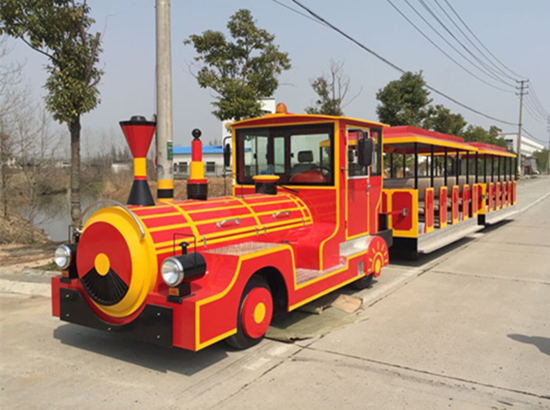 Antique trackless train with electric power