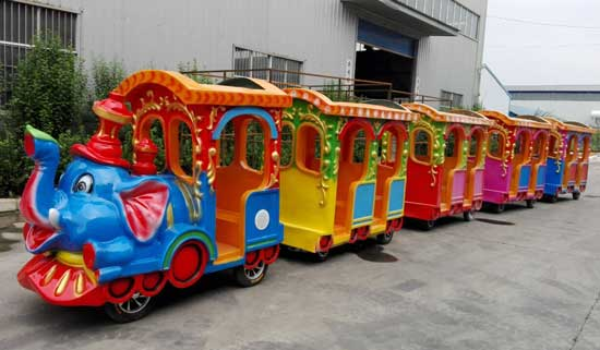 amusement park elephant train ride with 4 coaches